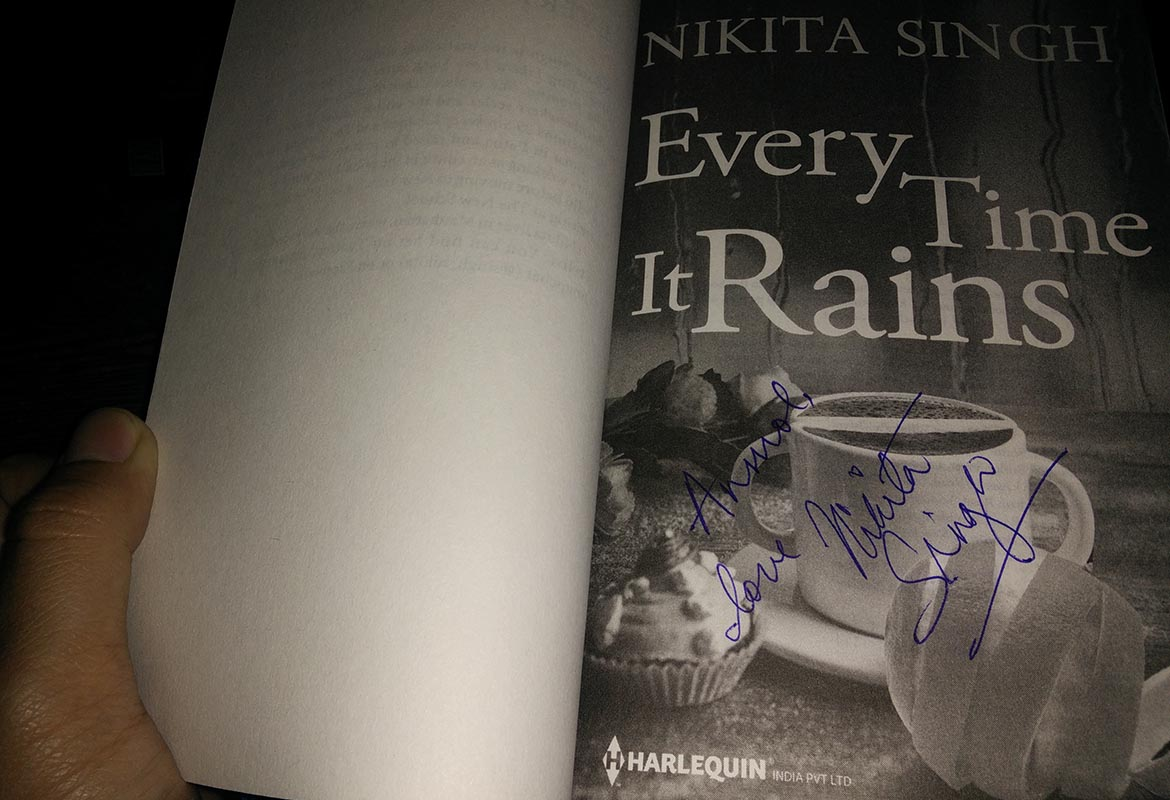 Autographed Copy of Every Time It Rains